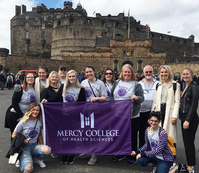 Mercy College students in front of Edinburgh Castle