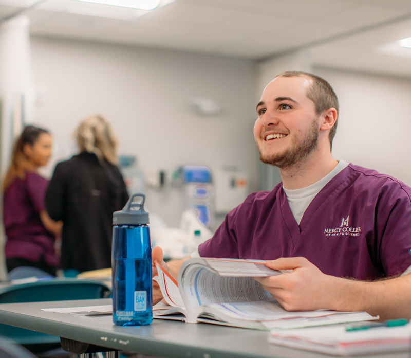 Male nursing student studying